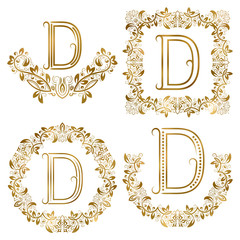 Golden D letter ornamental monograms set. Heraldic symbols in wreaths, square and round frames.