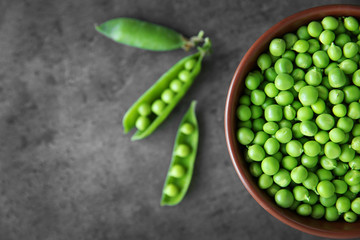 Fresh green peas in bowl, closeup