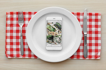 Cellphone on plate. Food blog concept