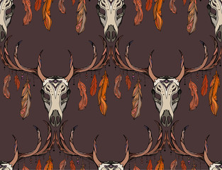 Seamless texture deer skull with horns, feathers and boho pattern. Vector background for your creativity