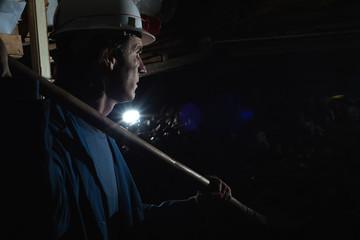 miner shoveling the coal