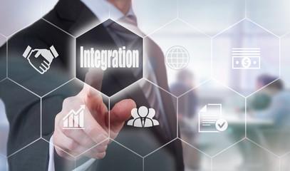 A businessman selecting a Integration Concept button on a hexagonal screen