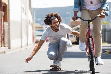 Friends enjoying with skateboard