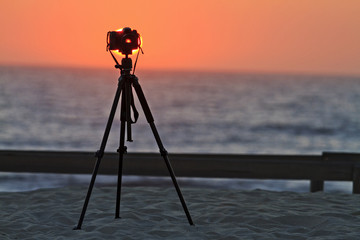 camera on a tripod at the beach