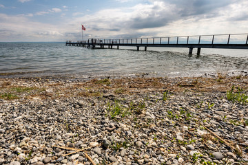 Lake Constance and new pier with swiss flag