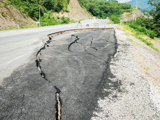 asphalt road cracked and broken texture