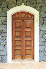 Wooden front door of a home. Front view of a wooden front door