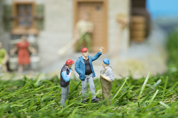group of mini worker talking on home garden