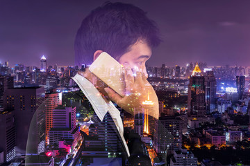 double exposure of businessman and cityscape