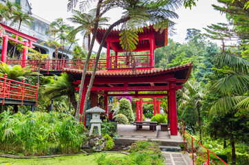 Lovely park on the island of Madeira - Monte Palace Tropical Garden. The red Chinese-style pavilions.