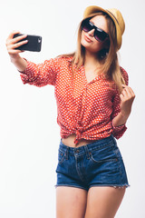 Happy cute woman making selfie over white background.