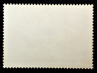 The blank Postage Stamp isolated on black background