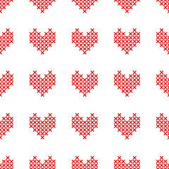 Seamless pattern with cross-stitch hearts on white