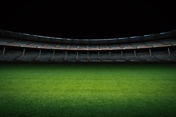 empty stadium with green field