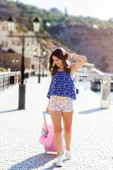 Girl going to vacations with pink suitcase