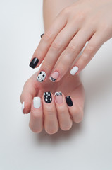 Black and white manicure with multicolored pepper and a bow on the square nails
