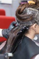 A brunette girl having her hair coloring