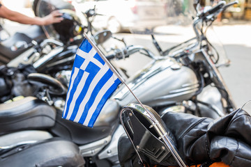 Selective focus of Greece flag attached to motor bike