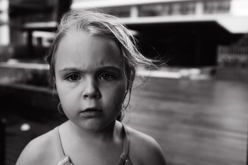 Girl looking at camera, black and white portrait