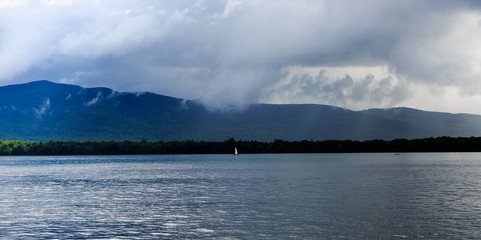 Lake George from the paddle boat during rain storm and clouds.