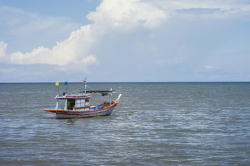 traditional fishing boat laying alone on the sea,selective focus,filtered image