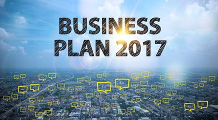 BUSINESS PLAN 2017 text on city and sky background with bubble c