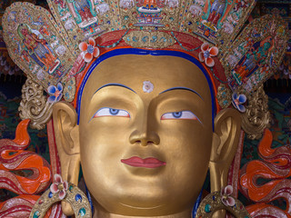 Head of a golden Buddha inside  temple at Thikse monastery. Ladakh, India