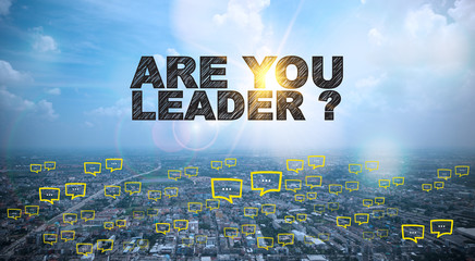 ARE YOU LEADER  text on city and sky background with bubble chat