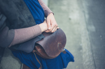 Woman with handbag outside