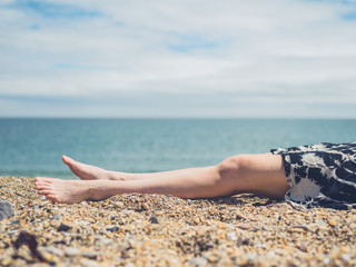 Legs of young woman on the beach