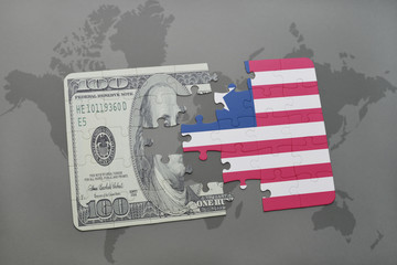 puzzle with the national flag of liberia and dollar banknote on a world map background.
