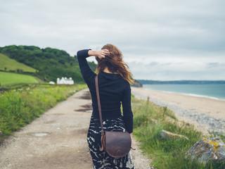 Young woman walking near the coast