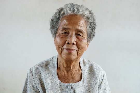 Smilling of happy Asian elderly senior on white background