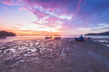 Purple Sunrise view with boats and Penang Bridge from Hammer Bay, George Town Penang, Malaysia