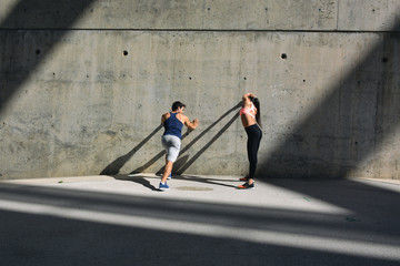 Young couple doing workout on a summer day