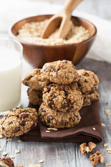 Homemade Oatmeal cookies and a glass of milk, selective focus