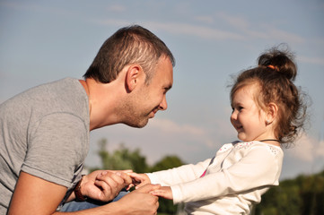 Happy father with his daughter outdoors