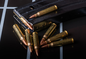 Ammunition in Magazine .223/556 on Black Surface