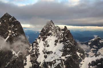 Aerial Landscape of the beautiful mountain peaks in British Columbia, Canada. Taken on a cloudy sunset near Vancouver.