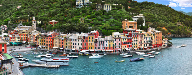 The beautiful Portofino panorama with colorfull houses,boats and yacht in little bay harbor. Liguria, Italy