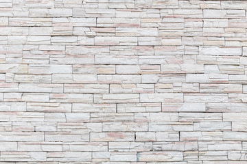 Pattern of natural stone wall and flower plant. Garden decorativ