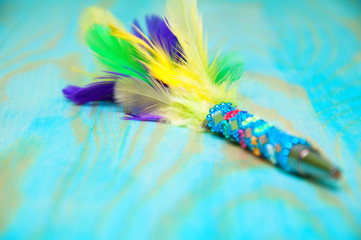 Decorative pen with colorful feathers