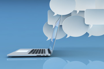 Communication technology, social networking, internet and online messaging concept, white empty speech bubbles and modern laptop computer on blue background with reflection