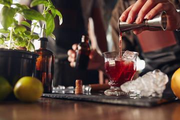 Bartender preparing fresh negroni cocktail