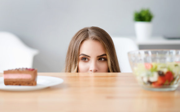 Pleasant crafty woman choosing what to eat
