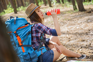 Relaxed female tourist resting in nature