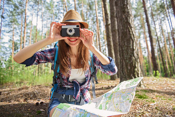 Cheerful woman using camera in journey