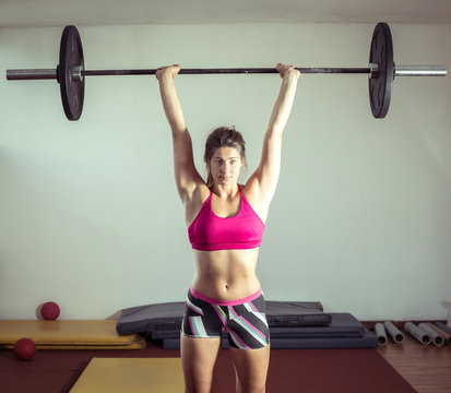 Girl doing weightlifting