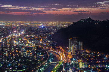 Fototapete - Night view of Santiago de Chile toward the east part of the city, showing the Mapocho river and Providencia and Las Condes districts