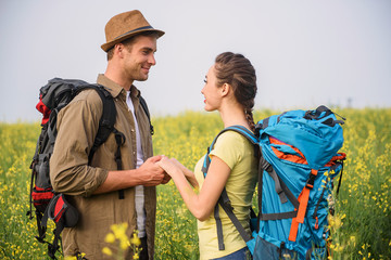 Joyful young man and woman on romantic trip
